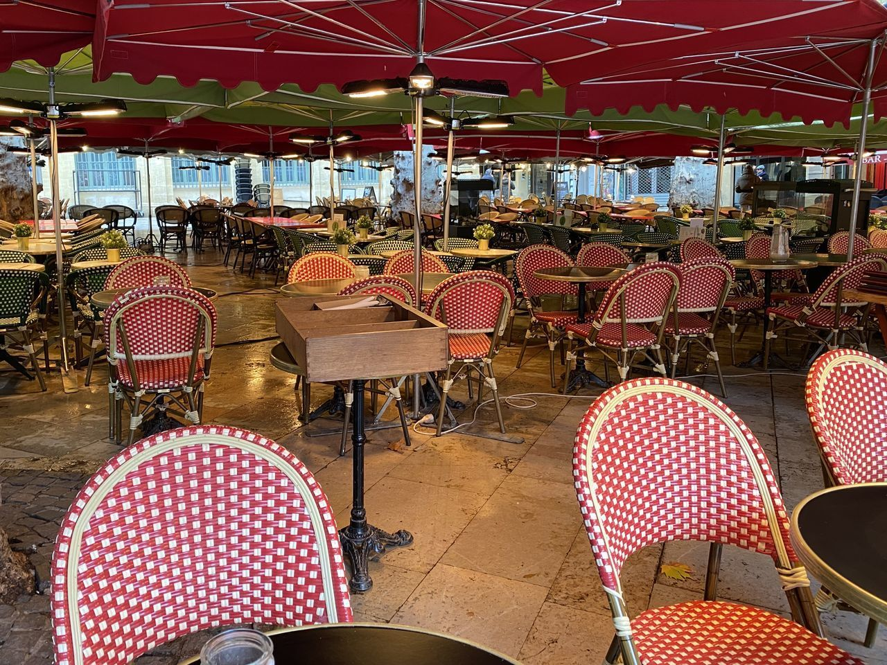 chair, seat, table, restaurant, red, cafe, business, absence, food and drink, indoors, empty, architecture, no people, furniture, sidewalk cafe, food and drink industry, tablecloth, illuminated, day, setting