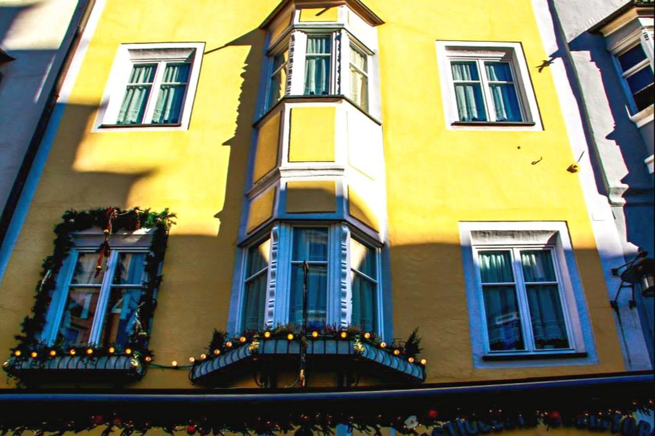 window, building exterior, architecture, built structure, low angle view, yellow, no people, outdoors, day, sky