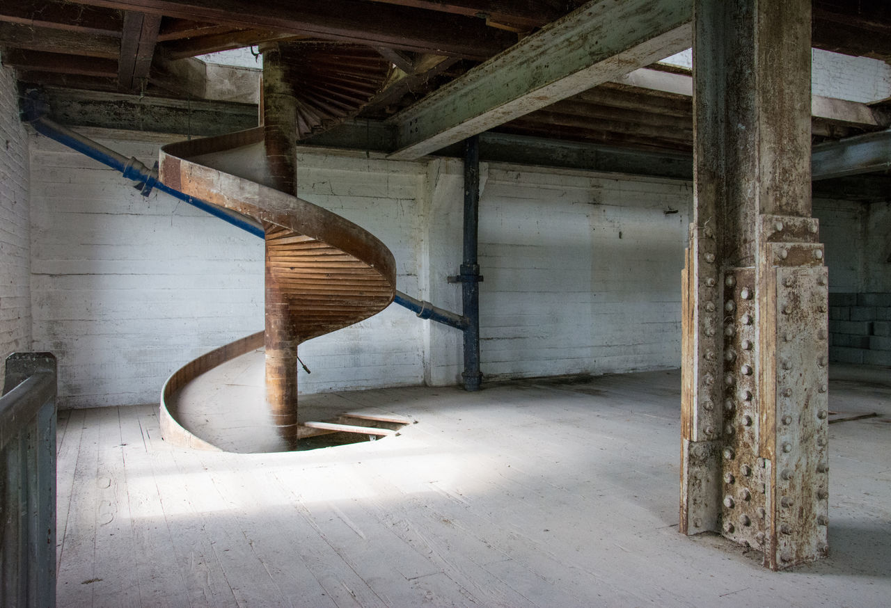 Spiral staircase in abandoned building