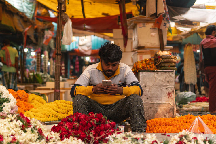 Man sitting at market stall