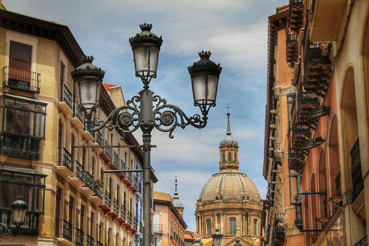 Low Angle View Of Street Lights By Cathedral-Basilica Of Our Lady Of The Pillar Against Sky