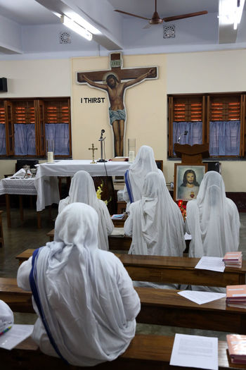 Sisters of Mother Teresa's Missionaries of Charity in prayer in the chapel of the Mother House, Kolkata, India at February 07, 2014. Missionaries Agnes ASIA Bojaxhiu Calcutta Catholic Charity Christianity Faith Gonxhe Humanitarian India Kolkata Mission Mother Mother House Nun Poor  Pray Prize Religious  Sister Teresa West Bengal