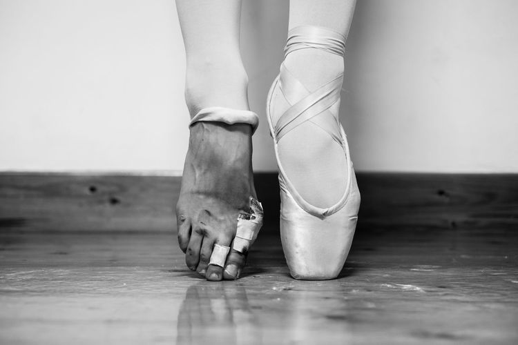Low Section Of Female Ballerina Tiptoeing