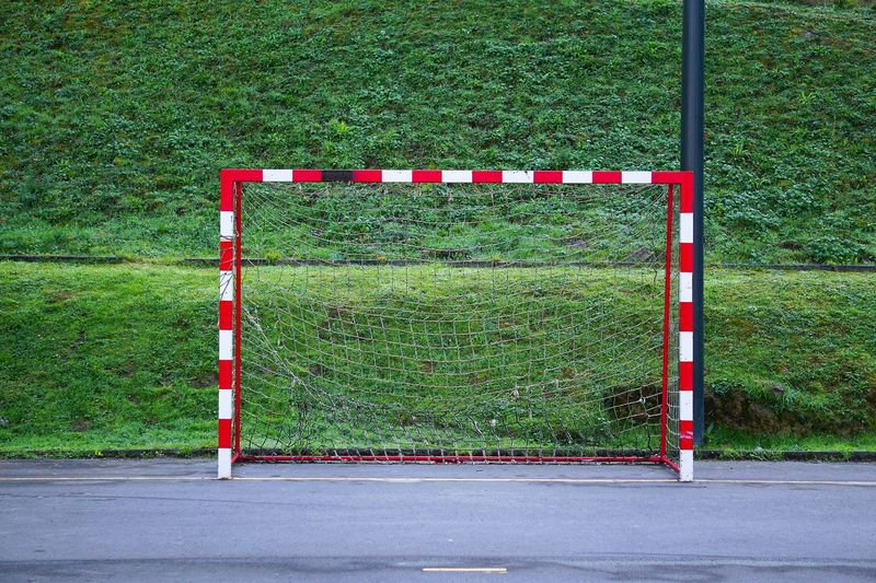 Goal post on soccer field against grass