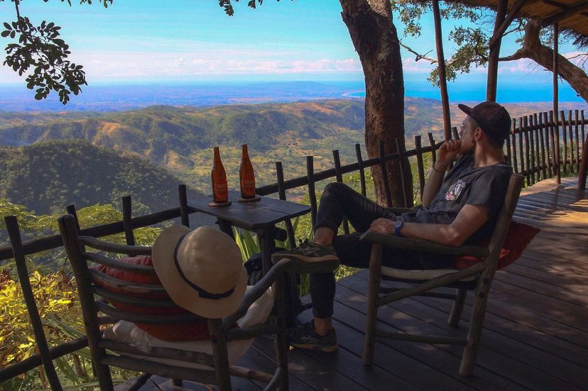 Chair Real People Leisure Activity Mountain Nature Sitting Full Length Table Day Sky Scenics Sea Beauty In Nature Lifestyles Vacations Relaxation Outdoors One Person Landscape Man Sitting Man Reflection Connected By Travel Lost In The Landscape