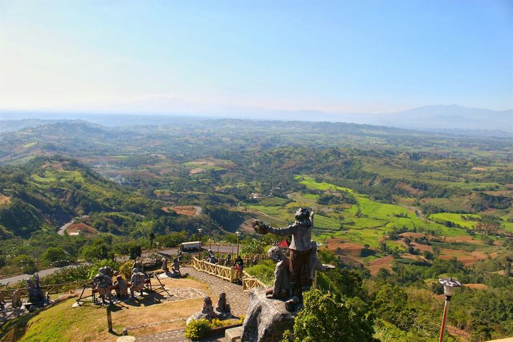 High Angle View Of Statues By Landscape Against Sky At Bukidnon