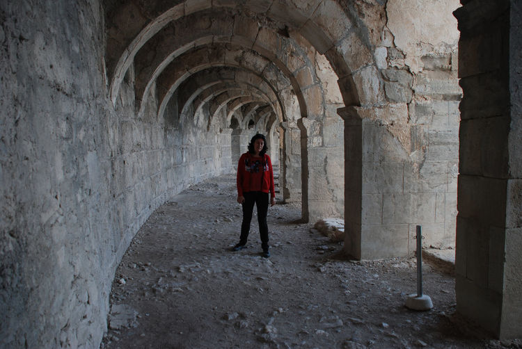 Walking through arhes Ancient Civilization Ancient Civilizations Ancient Ruins Ancient Theatre Antalya Architecture Aspendos  Day Full Length Indoors  One Person One Woman Only Only Women People Roman Arch Roman Architecture Standing Theatre Travel Tunnel Turkey Vacations