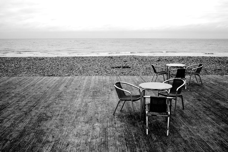 No Coffee For Me! Black & White Littlehampton Beach Blackandwhite Chair Horizon Over Water Outdoors Place Setting Scenics Sea Sky Table Tranquility Water