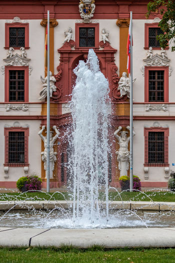 Water fountain against building