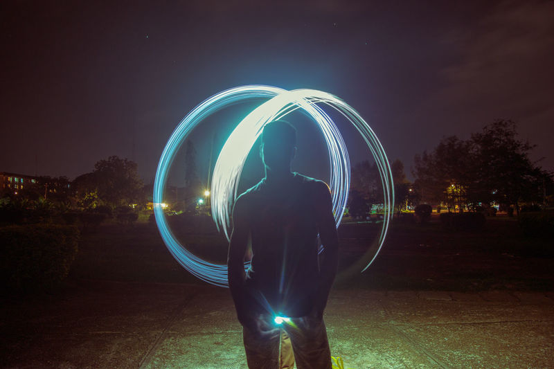Night lights Night Illuminated Glowing Circle One Person Standing Long Exposure Silhouette People One Man Only Light Trail Men Only Men Adult Adults Only Outdoors Cyberspace Sky Wire Wool Galaxy Nightphotography Steelwoolphotography Ifechiworks Nigeria EyeEm Best Shots