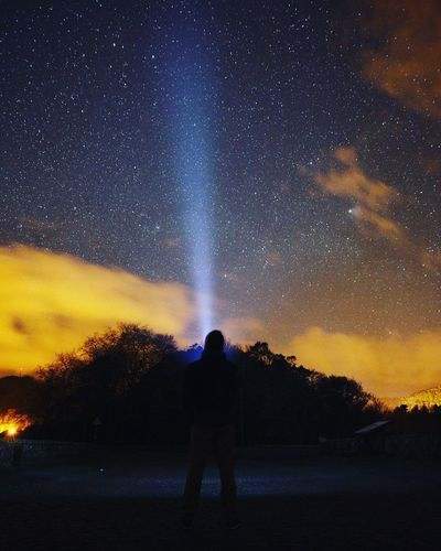 Rear View Of Silhouette Man Standing Against Star Field