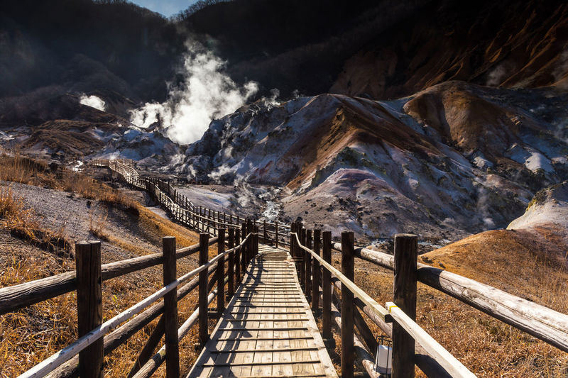 Footbridge leading towards mountains