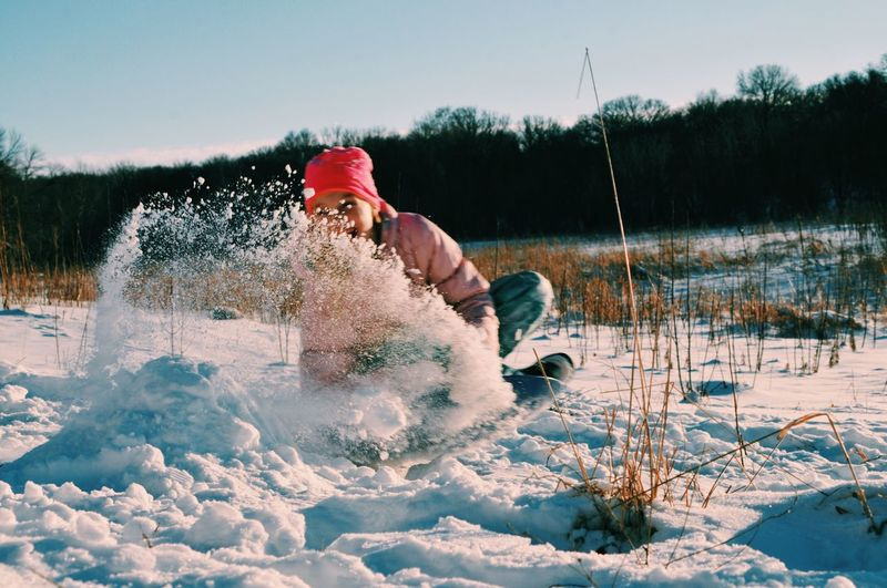 Full Frame Cold Temperature Snow Season  Leisure Activity Weather Lifestyles Nature Vacations Field Water Scenics Beauty In Nature Focus On Foreground Outdoors Day #non Urban Winter Tranquil Scene Person Splashing