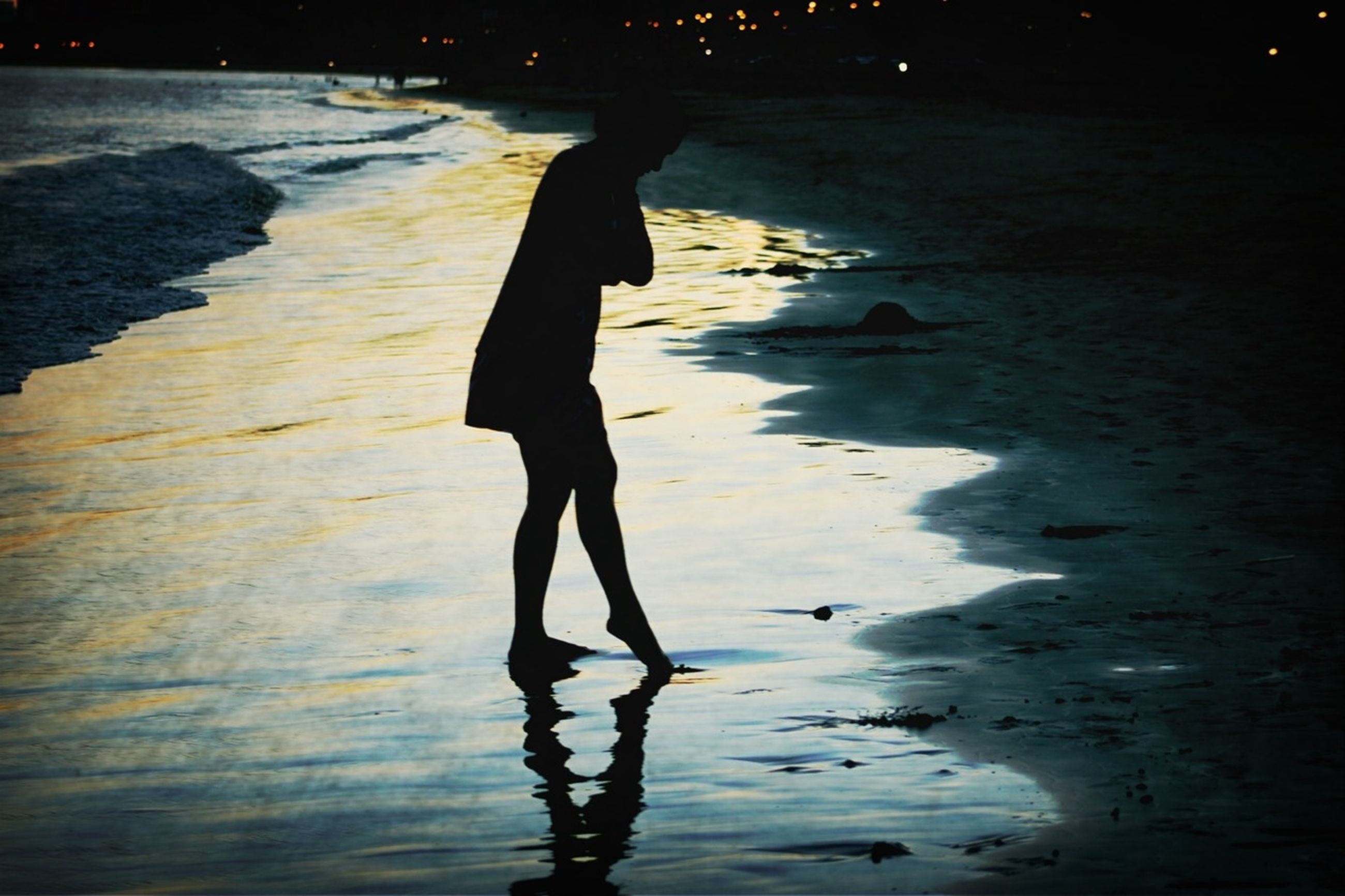 silhouette, water, beach, lifestyles, standing, reflection, leisure activity, shore, shadow, walking, men, full length, sand, sunlight, sea, nature, night, outdoors
