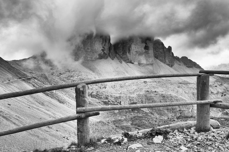 Railing Against Mountains At Tre Cime Di Lavaredo During Foggy Weather