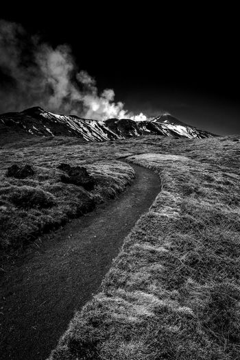 Etna Beauty In Nature Cloud - Sky Day Direction Environment Etna Black And White Field Grass Land Landscape Mountain Nature No People Non-urban Scene Outdoors Pollution Power In Nature Scenics - Nature Sky The Way Forward Trail Tranquil Scene Tranquility