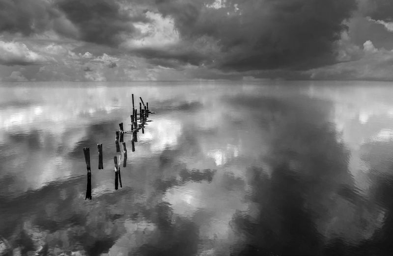 Scenic View Of Cloudy Sky Reflecting On Sea