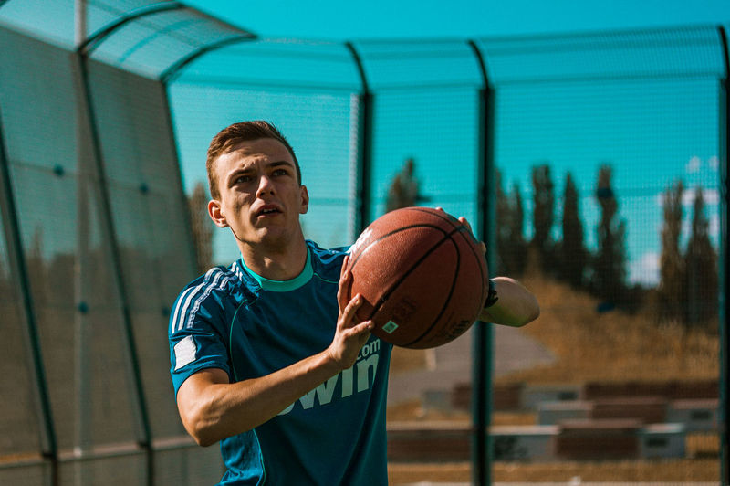 Basketball session in the evening. Action Active Basketball Blue Casual Clothing Concentration Contrast Day Evening Light Focus Focused Gym Person Sport Sports Photography Sunset Streetphotography TakeoverContrast Urban Urban Landscape USA Vibe Youth Dramatic Angles