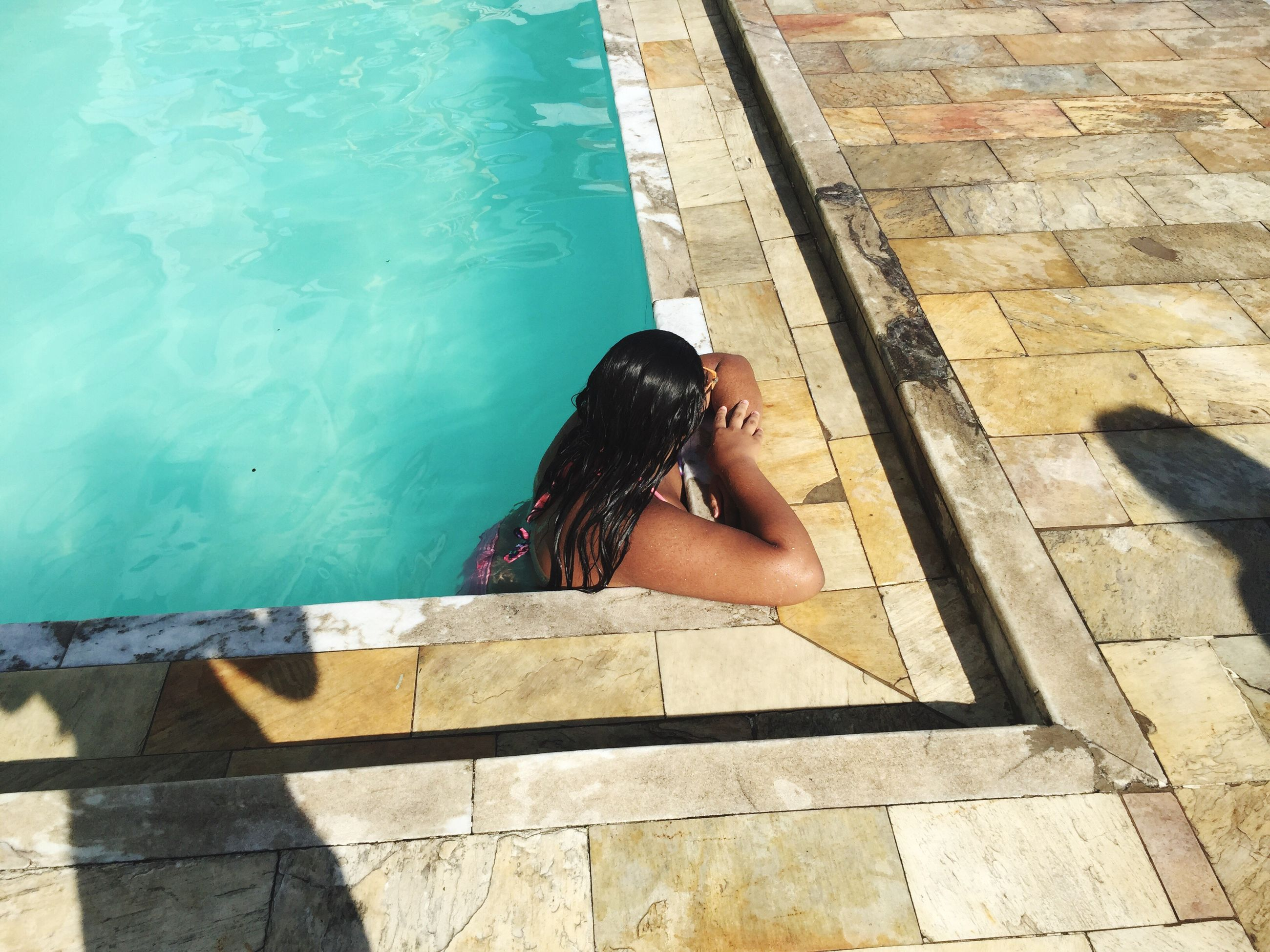 one person, sunlight, outdoors, women, adult, swimming pool, one young woman only, young women, young adult, leisure activity, one woman only, only women, day, real people, people, adults only