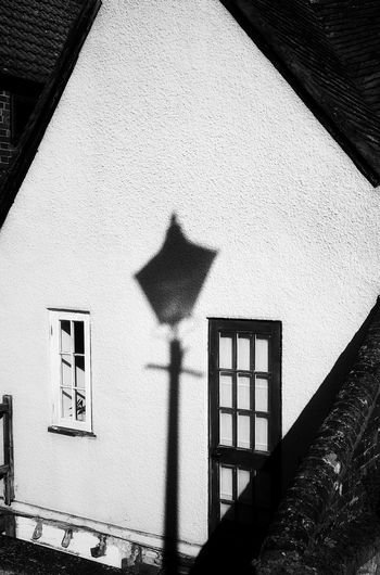 Low angle view of lamp against building