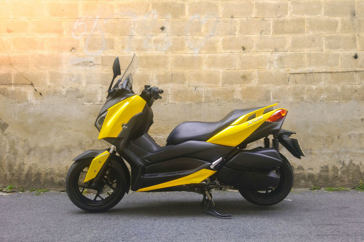 Side view of motor scooter on wall