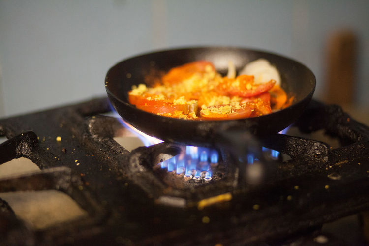 Frying Pan With Food On Stove