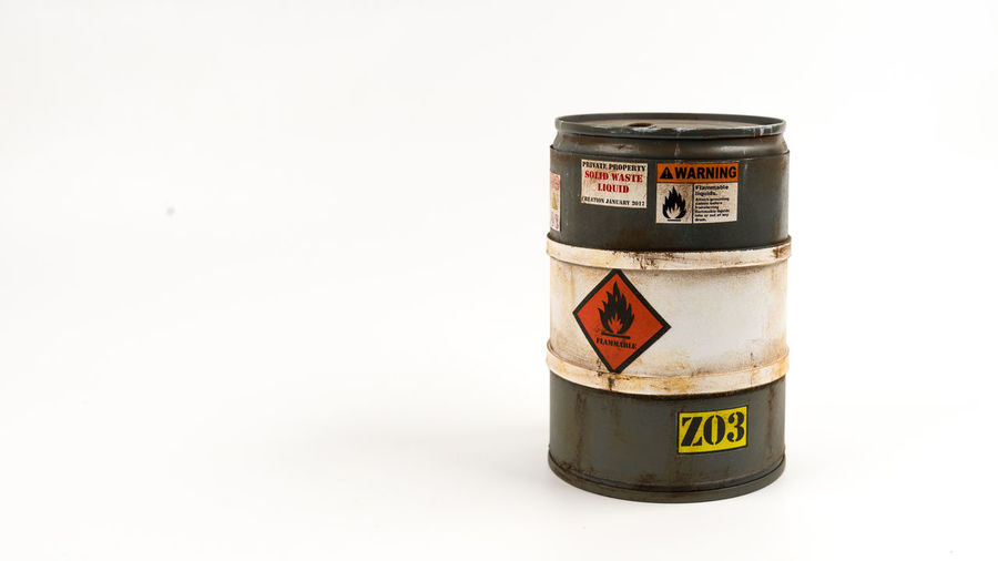 Miniature of grey colour barrel or flammable drum. Concept of dangerous or explosive material. Isolated on white background. Slightly de-focused and close-up shot. Copy space. Barrel Container Danger Explosive Flammable Flammable Liquids Fuel, Hazard Miniature Oil Barrel Petrol Radioactive Risky Rusty Tank