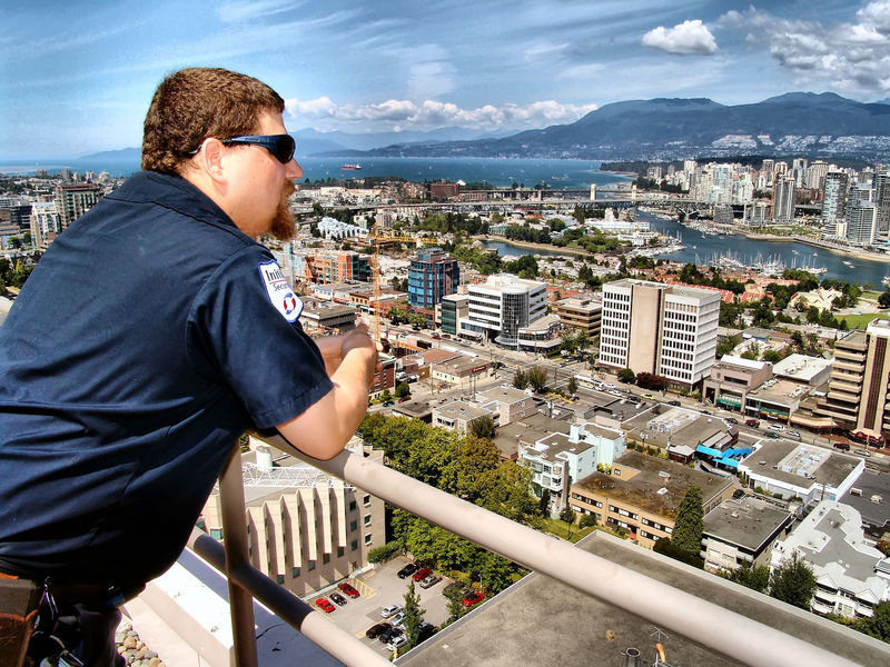 Security guard on the rooftop of Vancouver General Hospital. Vancouver B.C. Canada. One Man Only Cityscape One Person Adult Outdoors Day Urban Skyline Canada B.C Vancouver BC Skyscraper