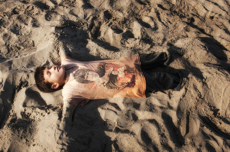 Finding zen in the sand. Beach Bruce Lee Buried In Sand Son Young Boy