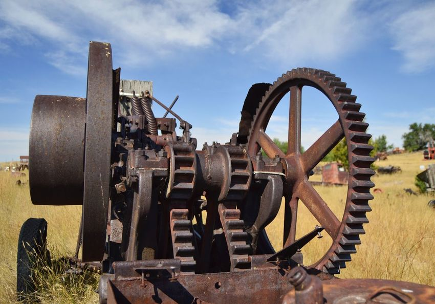 Machinery Gears Machine Outdoors Clouds And Sky North Of Douglas Wyoming Sunshine Shadow Deteriorated Junkyard Rusted Old Weathered Metal