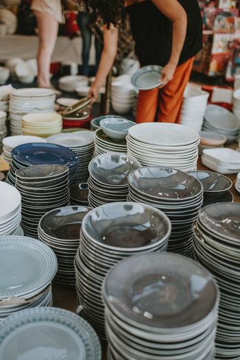 High angle view of plates for sale at market stall