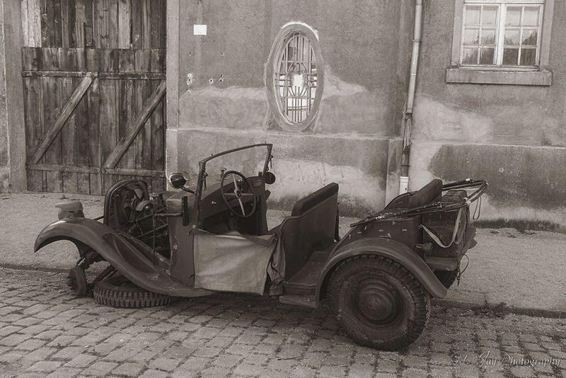 Vehicle Old Car Sepia Postwar  History Street Cobblestones Wall Building Streamzoofamily EyeEm Masterclass Eye4photography  Capture The Moment HuaweiP9 Germany Taking Photos Old Car Sepia_collection Door Window Wooden Door EyeEm Best Edits Throwback Antique
