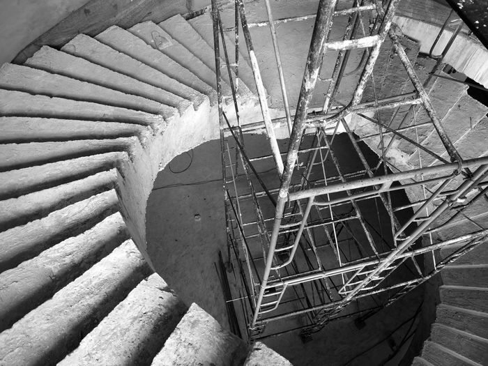 Steel girder situated on the spiral staircase in construction Blackandwhite Black And White Black & White Scaffolding Construction Site Scaffold Safety Industry Worker Background White Background Isolated Industrial Structures & Lines Structure Work Infrastructure Frame Steel Engineering Project Design Black Architechture Ladder Building Trade Occupation Hate Tower Male Working Development Buildings New Metallic Houses Equipment Manual Focus Iron Architecture Staircase Steps And Staircases No People Built Structure Pattern Day High Angle View Spiral Indoors  Railing Spiral Staircase Shadow Sunlight Metal Old