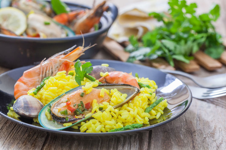 Black spaghetti with shrimps and sausage Clams Cooked Cuisine Food Gourmet Meal Meat Mussel Paella Prawn Rice Risotto Seafood SHELLFISH  Shrimp Spanish Spice Traditional