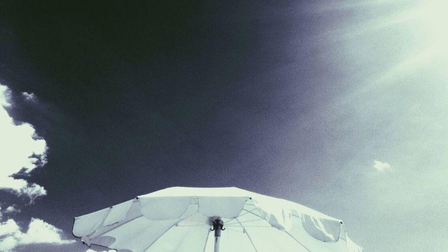 Blue Cloud Cloud - Sky Grain Minimal Minimalism Minimalist Minimalobsession Outdoors Simplicity Sky Sun Rays Sunbeam Umbrella Umbrellas White White Color White Umbrella Wind