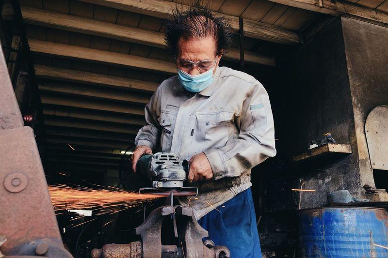Man working on metal grate