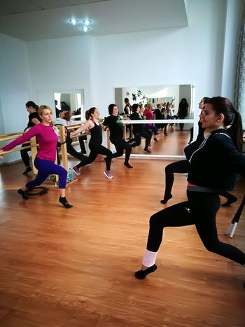 Barre Exercising Healthy Lifestyle Lifestyles Indoors  Practicing Balance Sports Clothing Young Women Health Club Young Adult Women