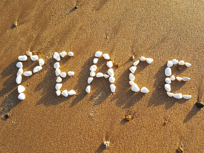 Large Group Of Objects Peace PEACE NO WAR Peace Gallery Words Of Wisdom Word Peace Writing Letters Pebbles Pebble Stones Peace With Pebble Stones Word With Pebbles Letters On Beach