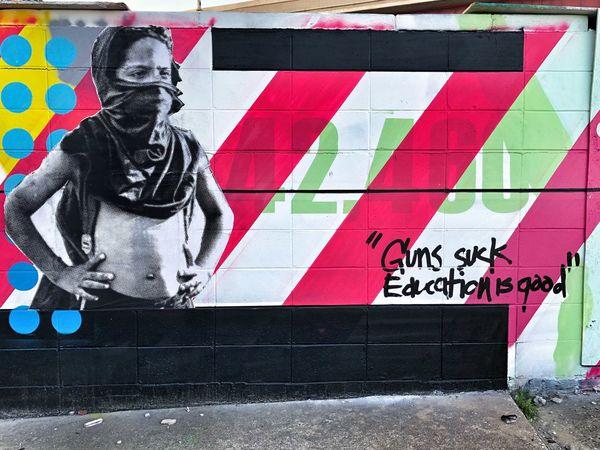 Guns suck, education is good Vscocam VSCO Murals Wallart Art Installation Tulsaexplorersclub Tulsa Art Installation Art And Craft Text Creativity Day Graffiti Representation Human Representation Street Art Transfer Print