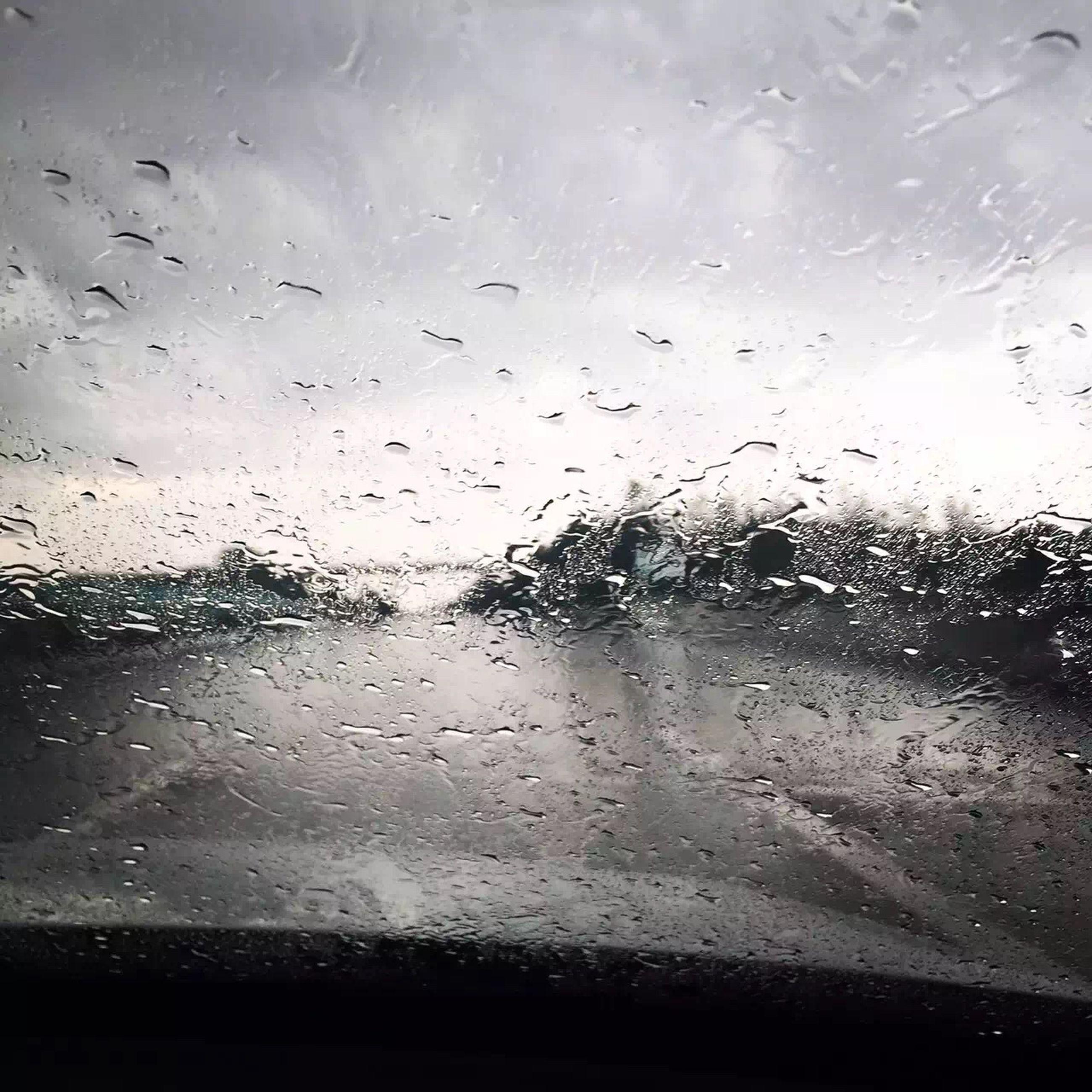 drop, wet, window, water, transparent, rain, glass - material, indoors, weather, raindrop, sky, season, glass, full frame, backgrounds, looking through window, cloud - sky, monsoon, dusk, silhouette