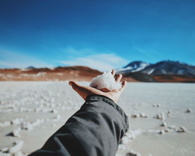 Person holding snow on palm