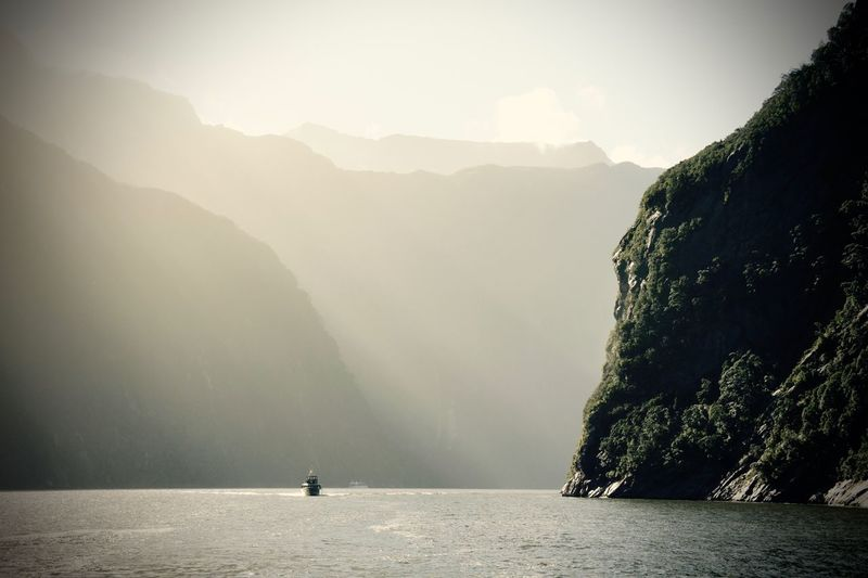 Scenic View Of Milford Sound By Mountains Against Sky