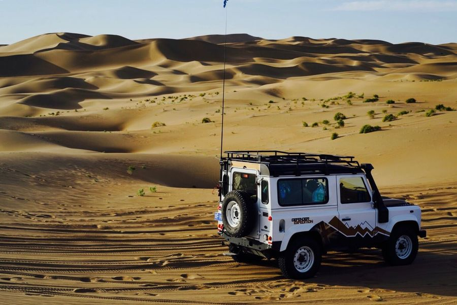 DesertDefender Desert Landscape Sand Dune Arid Climate Sand Nature Off-road Vehicle Land Vehicle Sky No People Outdoors Beauty In Nature Day Mammal Landrover Defender Landrover  Be. Ready.