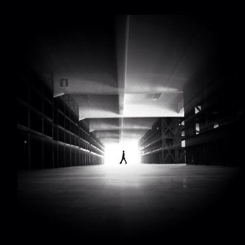 Full length of woman walking on tiled floor