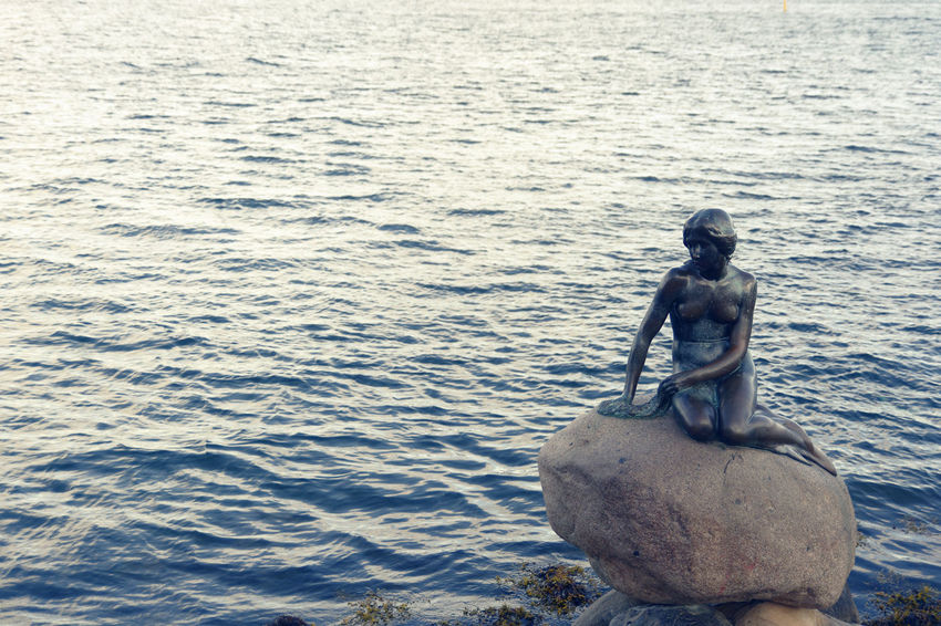 Copenhagen, Denmark Den Lille Havfrue Art And Craft Day High Angle View Human Representation Male Likeness Marmaid Nature No People Outdoors Representation Rippled Rock Rock - Object Sculpture Sea Sitting Solid Statue Water Waterfront EyeEmNewHere