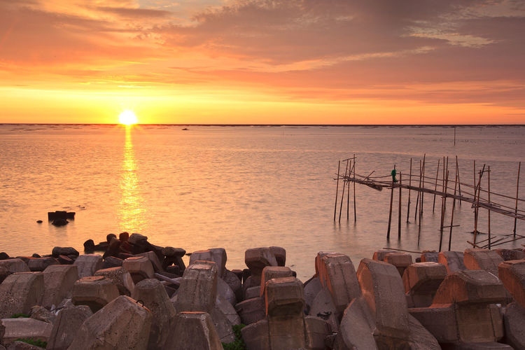 EyeEmNewHere Yunlin County, Kouhu, Fishing Port Beach Beauty In Nature Cloud - Sky Fishing Pole Groyne Horizon Over Water Nature Nautical Vessel No People Orange Color Outdoors Rock - Object Scenics Sea Sky Sun Sunset Tranquil Scene Tranquility Water