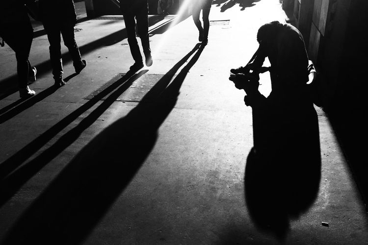 Conceptual silhouette of person begging on street