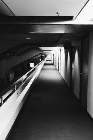 Endless hallway in the ICC spaceship. Indoors  The Way Forward Architecture Illuminated No People Perspective Retro Architecture_collection Black & White ICC Entryway Urbanphotography Futuristic Abandoned Berlin Berlin Photography Light And Shadow Black And White Collection  Abandoned Places Urbanexploration Archilovers Minimal_perfection Abandon_seekers Urban Geometry Hallway Minimalist Architecture