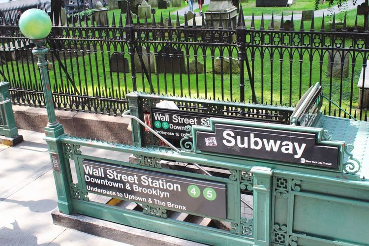 Transportation Public Transportation City New York Wall Street  Subway Subway Station Text Metal Communication Green Color No People Day Outdoors