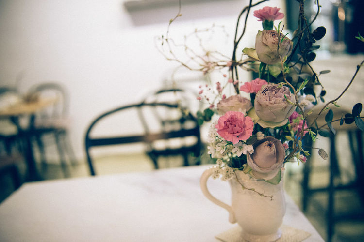 High angle view of flower vase on table at cafe